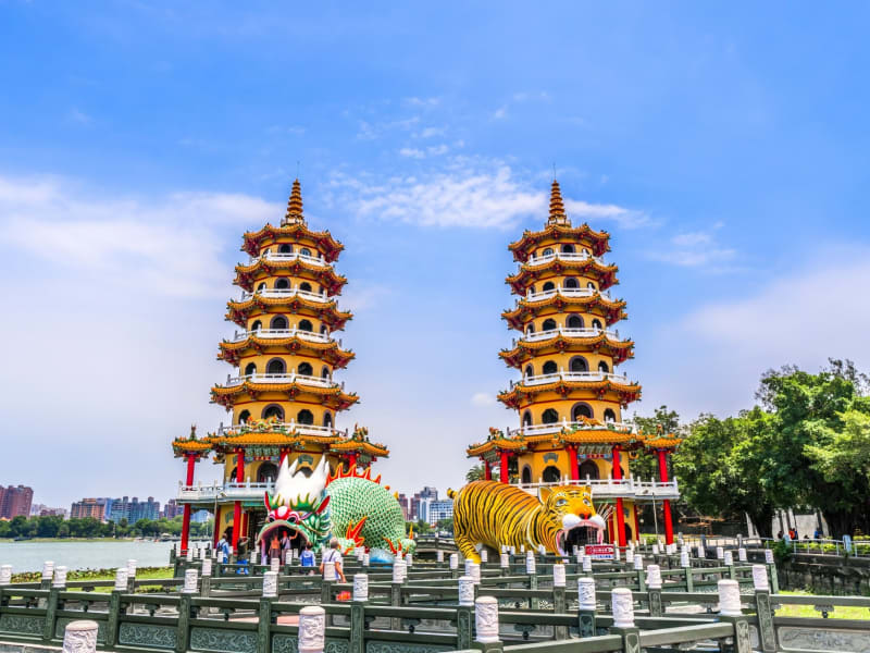 View Tiger Dragon Pagoda, the larger-than-life statues and pagodas at Lotus Pond.