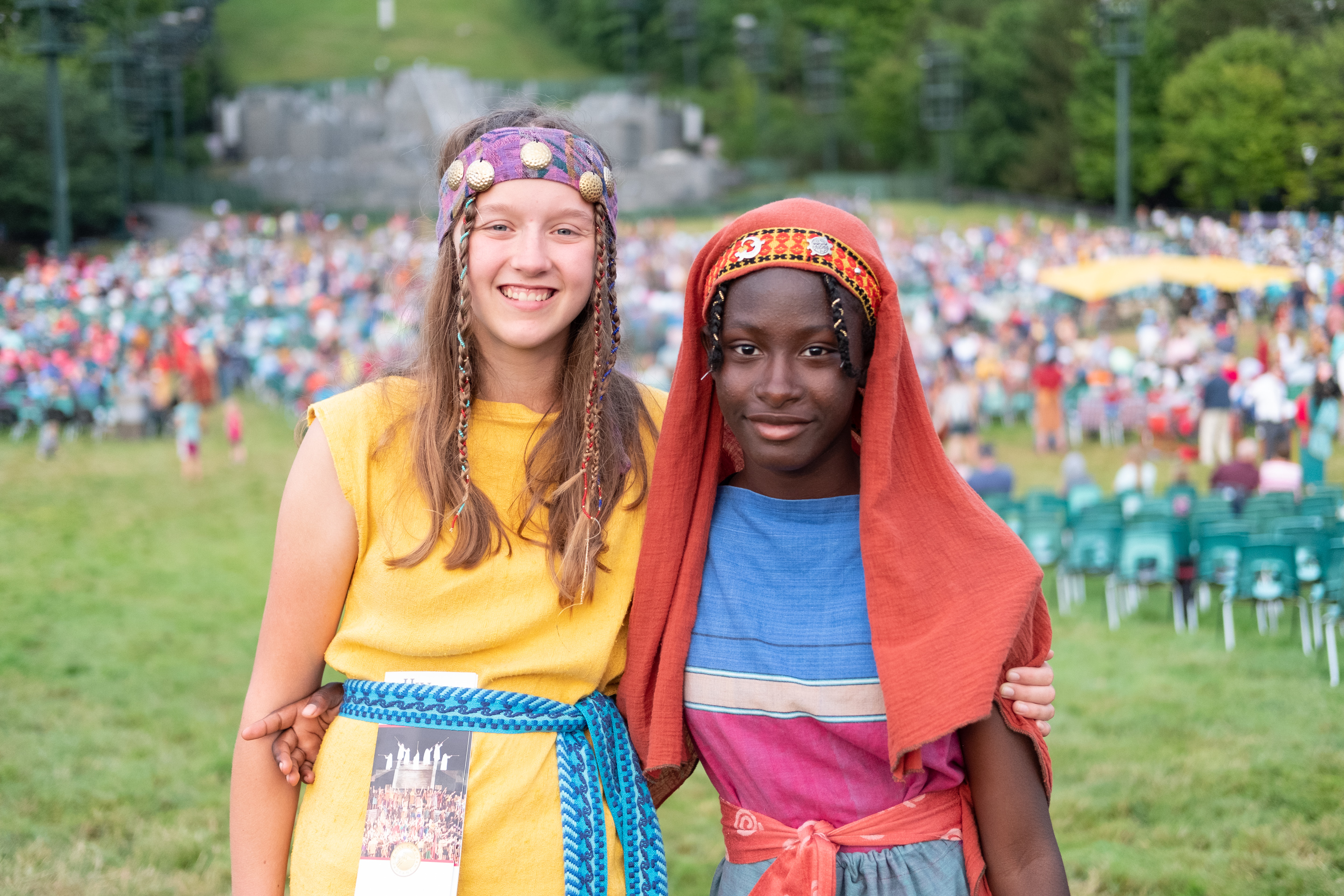 Two participants welcome visitors to the yearly Hill Cumorah Pagaent, Palmyra, NY, 2019