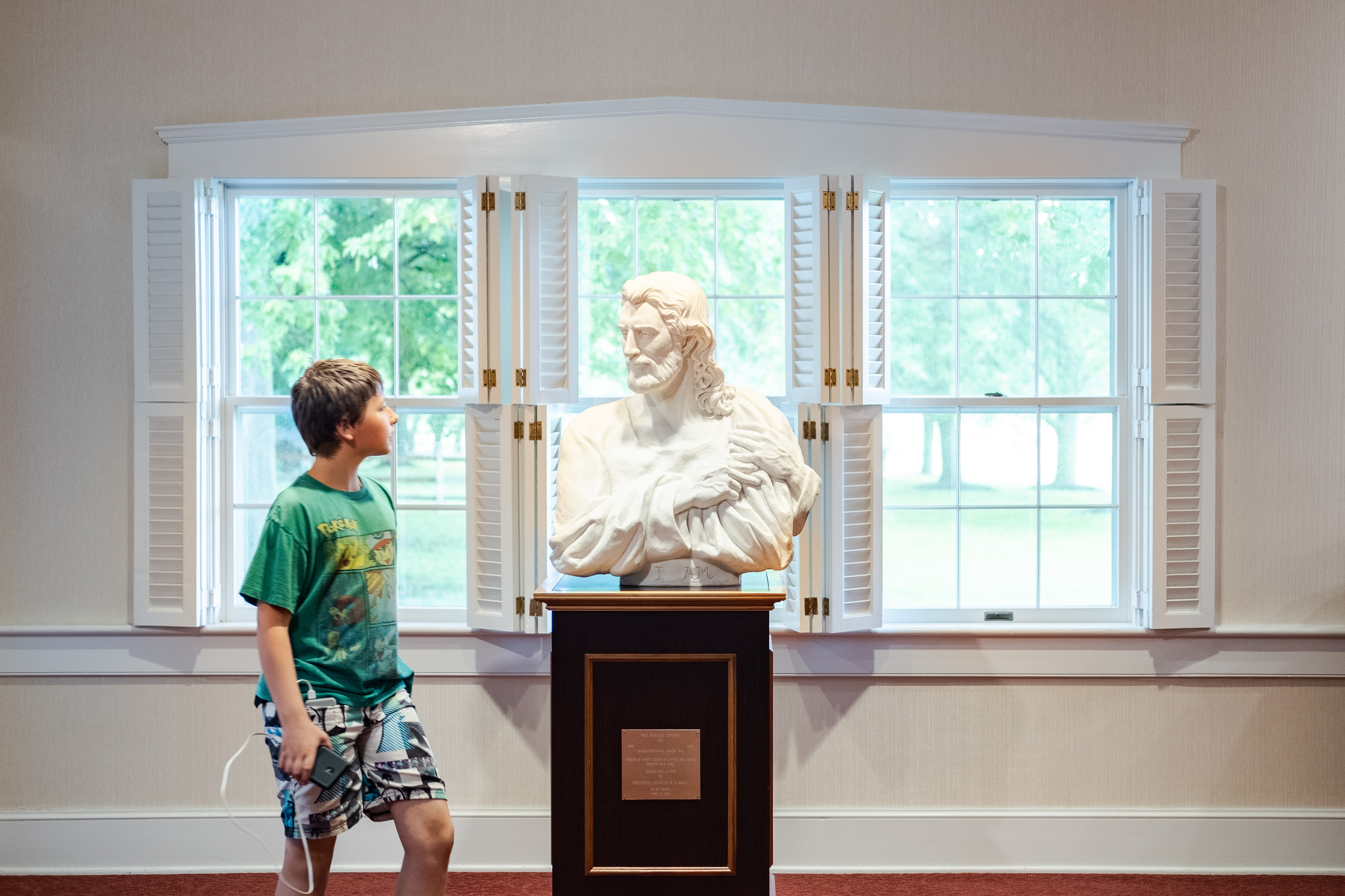Boy and Bust of Christ at Whitmer Farm Visitors' Center, Waterloo, NY, 2019