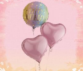 Pink coloured birthday balloons