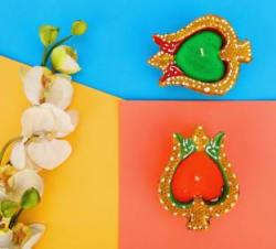 Flipkart SmartBuy 4 Pcs Handmade Lotus Shape Waxed Clay Diya Set for Diwali Decoration Candle Multicolor, Pack of 4