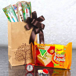 Giftacrossindia Three Designer Rakhis With Laxmi Ganesha Coin And Soan Papdi
