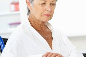 Elderly Woman in White Blouser