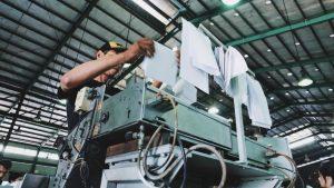 Worker using a mechanical machine