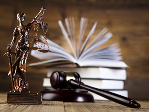 Lady of justice with gavel and open book