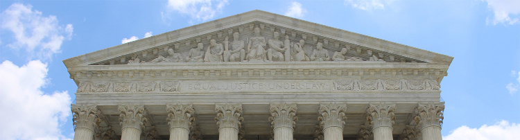 Front of courthouse that reads EQUAL JUSTICE UNDER LAW