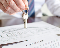 Attorney holding a ring of keys over a contract