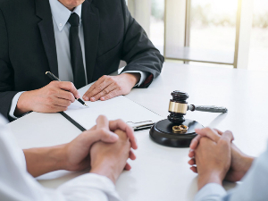 Attorney meeting with couple filing for divorce