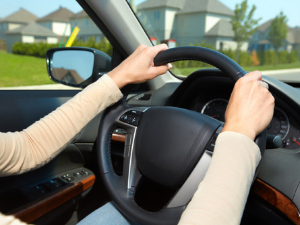 2 hands on the steering wheel while driving