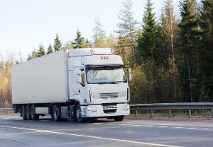 Semi-truck driving down the road
