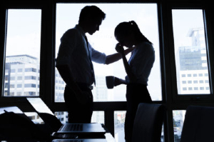 A man consoling a distressed woman