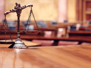 Scales of justice in an empty courtroom
