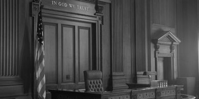 Courtroom with chair and desk in black and white