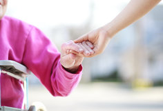 Elderly person holding someone's hand