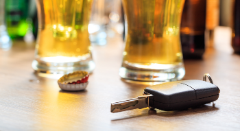Beer on a Bar next to Car Keys