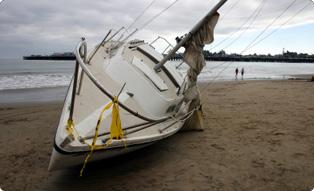 Sailboat on the sand near a lake