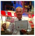 Joey Regan posing with american flag and certificate in Maynard, MA