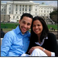 Hugo & Alfonsina Carabello sitting and smiling outside large white building in Milton, Massachusetts