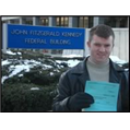 Niall McManus posing with blue paper in Beverly, Massachusetts