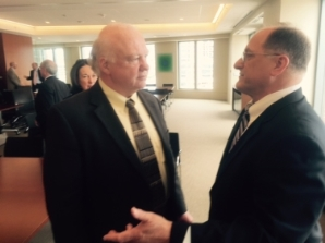 Attorney John Foley and Congressman Michael Capuano discussing immigration reform asylum and temporary protected status (TPS) at a luncheon