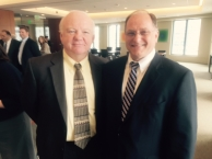 Congressman Capuano and Mike Foley wearing suits and smiling for photo
