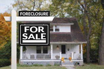 Foreclosure sign on for sale house
