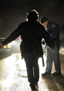 Police officer watching a possible drunk complete a sobriety test