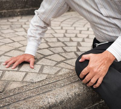 Man on ground holding his knee