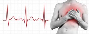 Shirtless man holding chest while a graph tracks his heartbeat