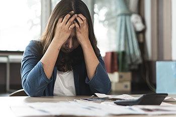 Woman stressed out by finances