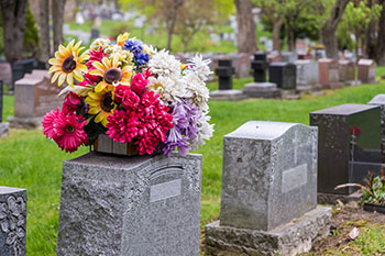 Flowers on top of a headstone