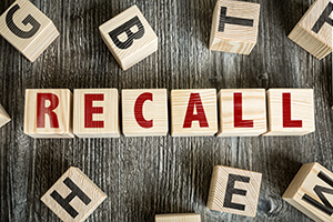 Wooden letter blocks spelling out Recall