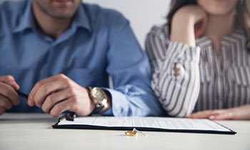 A man and woman look over documents