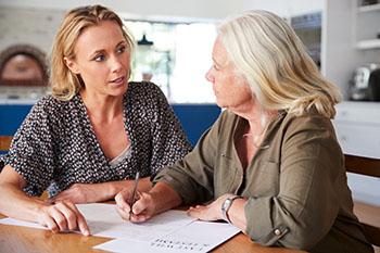 2 women working on their estate planning documents