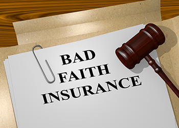 Bad faith insurance document in a folder with a gavel resting on top