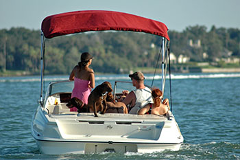 Family on a boat out on the lake