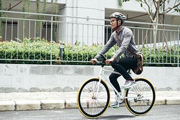 Man biking through the city