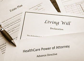 Estate plan, living will, and healthcare power of attorney documents on a desk