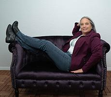 Carolyn N. Budnik on a couch