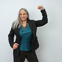 Carolyn N. Budnik posing with her fist in the air