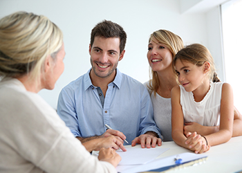 Two parents and their daughter discuss their estate plan with a laywer