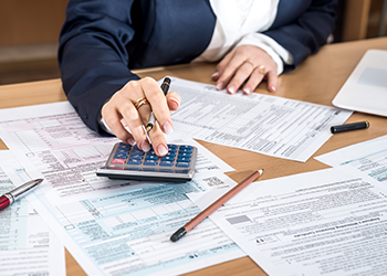 A business woman files her taxes