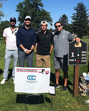 Ciardelli, Cummings, and Campagna team at golf course