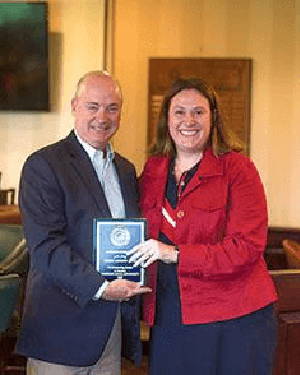 Patrick Cummings receives the Patriot Attorney Award from Amy Delaney of the Veteran's Legal Aid Society