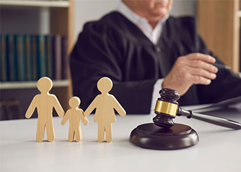 Wooden block family in front of a judge