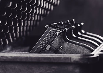 4 firearms resting in a gun safe