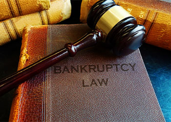Bankruptcy Book with Gavel on Top