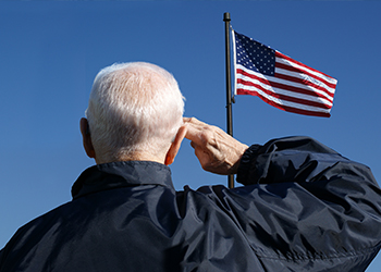 Man Saluting American Flag