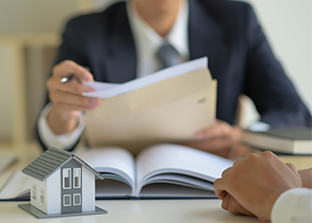 A lawyer goes over an estate plan with their client