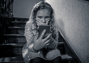 Little Girl Looking at Phone